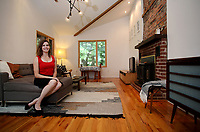 NWA Democrat-Gazette/DAVID GOTTSCHALK  Lori Yazwinski sits in her favorite personal space Monday, August 28, 2017, the living room of her home in Fayetteville.