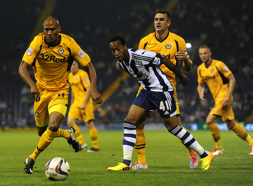 Newport County's Chris Zebroski vies for possession with West Bromwich Albion's Cameron Gayle<br /> <br /> Photo by Ashley Crowden/CameraSport<br /> <br /> Football - Capital One Cup Second Round - West Bromwich Albion v Newport County - Tuesday 27th August 2013 - The Hawthorns - West Bromwich<br />  <br /> &copy; CameraSport - 43 Linden Ave. Countesthorpe. Leicester. England. LE8 5PG - Tel: +44 (0) 116 277 4147 - admin@camerasport.com - www.camerasport.com