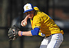 Thomas Paulich #4, Kellenberg third baseman, gets ready to throw across the diamond in the top of the fourth inning of a Nassau-Suffolk CHSAA varsity baseball game against St. John the Baptist at Eisenhower Park on Tuesday, April 18, 2017. He drove in two runs in Kellenberg's 6-2 win.