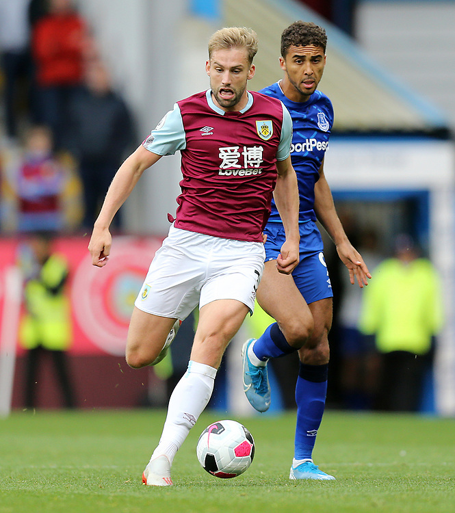 Burnley's Charlie Taylor under pressure from Everton's Dominic Calvert-Lewin<br /> <br /> Photographer Rich Linley/CameraSport<br /> <br /> The Premier League - Burnley v Everton - Saturday 5th October 2019 - Turf Moor - Burnley<br /> <br /> World Copyright © 2019 CameraSport. All rights reserved. 43 Linden Ave. Countesthorpe. Leicester. England. LE8 5PG - Tel: +44 (0) 116 277 4147 - admin@camerasport.com - www.camerasport.com