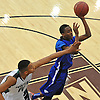 Terry Roberts #0 of Copiague, right, drives to the net during a game against Brentwood in the Gary Charles Hoop Classic at Adelphi Unversity on Sunday, Jan. 8, 2017. Brentwood won by a score of 65-61.