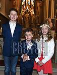 Diarmuid Loughnan from Scoil Aonghuasa who recieved First Holy Communion at St. Peter's church with brother Conor and sister Éile. Photo:Colin Bell/pressphotos.ie