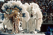 Rio de Janeiro, Brazil. Samba school; carnival King and Queen on a float during the parade through the sambadrome.