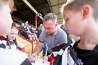 Picture by Allan McKenzie/SWpix.com - 22/04/2018 - Rugby League - Ladbrokes Challenge Cup - York City Knight v Catalans Dragons - Bootham Crescent, York, England - Catalan Dragons' coach Steve McNamara signs autographs for fans.
