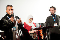 The Netherlands, Amsterdam, 25 November 2011. The International Documentary Film Festival Amsterdam 2011. QnA after screenin 5 Broken Cameras with makers Emad Burnat  (left) and Guy Davidi  (right, middle). Photo: 31pictures.nl / (c) 2011, www.31pictures.nl