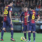 16.12.2012. Barcelona, Spain. La Liga day 16. Picture show Sergio Busquets, Leo Messi and Xavi in action during game FC Bracelona against Atletico Madrid at Camp Nou