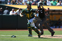 OAKLAND, CA - JULY 19:  Bruce Maxwell #13 of the Oakland Athletics chases a foul pop up against the Tampa Bay Rays during the game at the Oakland Coliseum on Wednesday, July 19, 2017 in Oakland, California. (Photo by Brad Mangin)