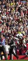 Photo. © Peter Spurrier/Intersport Images.15/05/2004  - 2003/04 Premiership Football - Arsenal v Leicester City:.Kolo Toure somersaults in front of the crowd[Credit] Peter Spurrier Intersport Images
