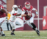 STAFF PHOTO ANTHONY REYES • @NWATONYR<br /> Arkansas' Brandon Allen runs the ball against Northern Illinois University in the first quarter Saturday, Sept. 20, 2014 at Razorback Stadium in Fayetteville.