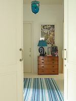 Guest bedrooms are simply furnished and accessorised with striped rugs