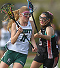 Mary Zarba #11 of of Holy Trinity, left, gets pressured as he races downfield during a non-league varsity girls lacrosse game against Friends Academy at Holy Trinity High School on Thursday, April 20, 2017. Holy Trinity won by a score of 12-9.