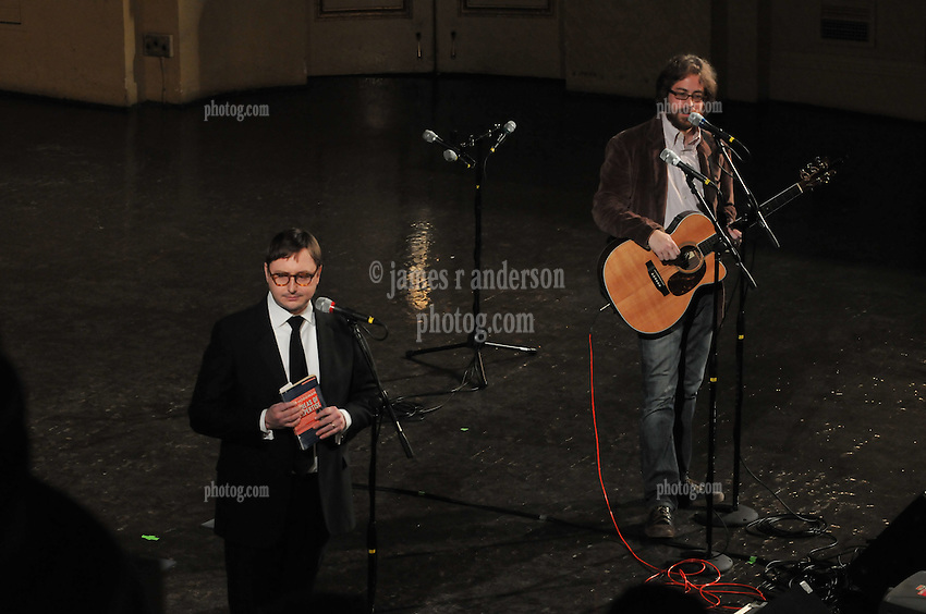 "Someone off stage distracting the comedy team, Jon Hodgman and Jonathan Coulton, as they try to set the mood for the ""Concert of the Century"" on a Spree: The Whiffenpoof Centennial (1909-20090"