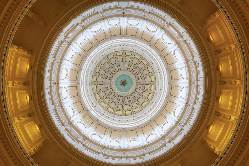 From the rotunda of the Texas State Capitol in Austin, this view looks straight up into the dome. The Texas star is at the top - 266 feet up - and is 8 feet across.