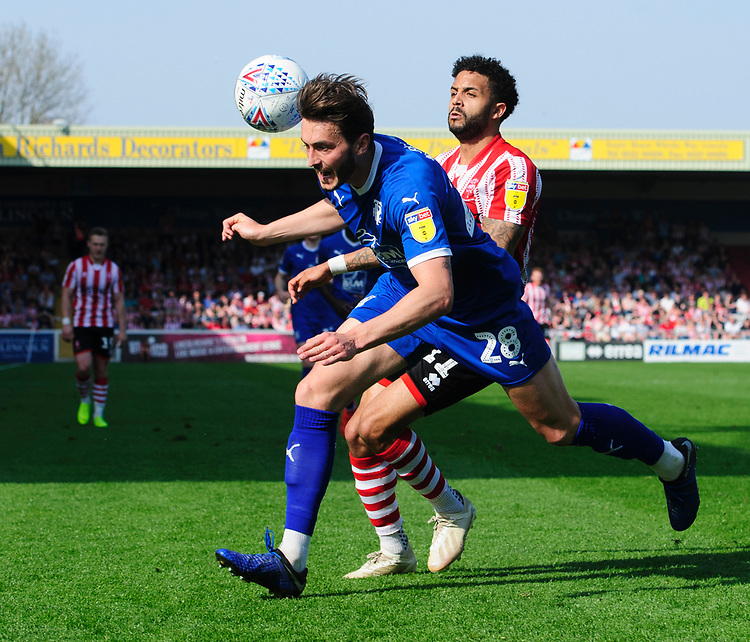 Tranmere Rovers' Oliver Banks is fouled by Lincoln City's Bruno Andrade<br /> <br /> Photographer Chris Vaughan/CameraSport<br /> <br /> The EFL Sky Bet League Two - Lincoln City v Tranmere Rovers - Monday 22nd April 2019 - Sincil Bank - Lincoln<br /> <br /> World Copyright © 2019 CameraSport. All rights reserved. 43 Linden Ave. Countesthorpe. Leicester. England. LE8 5PG - Tel: +44 (0) 116 277 4147 - admin@camerasport.com - www.camerasport.com