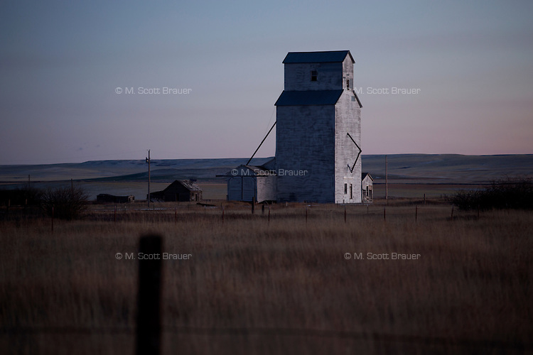 An old grain elevator stands above the plains in Buffalo, Montana.