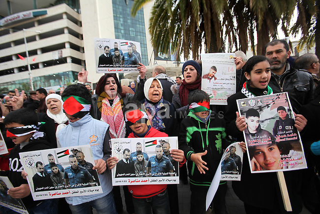 Palestinians take part in a demonstration demanding the release of a 13-year-old Ahmed Manasra, from Israeli jails, in the West Bank city of Nablus on Jan. 21, 2016. Israeli police have accused Manasra, together with his 15-year-old cousin, of attacking a 13-year-old Israeli boy on October 12, 2015 in Pisgat Zeev, built on occupied land that Israel annexed to Jerusalem after the 1967 war. The family has denied Manasra did it. Photo by Nedal Eshtayah