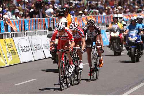 26.01.2014 Adelaide, Australia. Will Clarke (Drapac) leading the breakaway with Maxim Belkov (Katusha) and Julien Berard (AG2R La Mondiale) in Stage 6 of the Santos Tour Down Under 2014 Adelaide Street Circuit, South Australia on 26 January 2014
