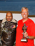 Buffalo Bills Rex Ryan (head coach NFL's Buffalo Bills) is presented an award by Black Angels' Over Tuskegee and poses with Layon Gray whose play was performed as a private performance on September 8, 2015 at Shea Performing Arts Center, Buffalo, New York. (Photo by Sue Coflin/Max Photos)