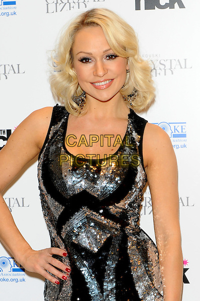 "Kristina Rihanoff.The ""A Night With Nick"" charity event in aid of The Stroke Association, Swarovski CRYSTALLIZED, Gt. Marlborough St., London, England..December 6th, 2011.half length black silver pattern sequins sequined dress sleeveless hand on hip  .CAP/CJ.©Chris Joseph/Capital Pictures."