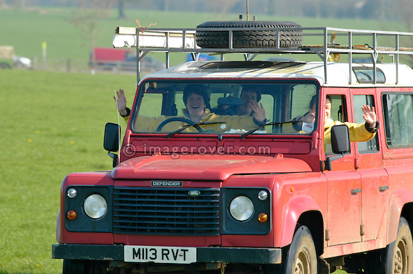 Louging women in a Land Rover Defender at the Old Sodbury Land Rover Sortout on April 2 at Newbury Showground UK 2005. The Old Sodbury Sortout is the biggest autojumble for buying and selling Land Rover parts.