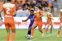 Houston, TX - Saturday June 17, 2017: Andressa keeps the ball away from Jamia Fields during a regular season National Women's Soccer League (NWSL) match between the Houston Dash and the Orlando Pride at BBVA Compass Stadium.