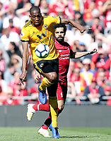 Wolverhampton Wanderers' Willy Boly controls under pressure from Liverpool's Mohamed Salah<br /> <br /> Photographer Rich Linley/CameraSport<br /> <br /> The Premier League - Liverpool v Wolverhampton Wanderers - Sunday 12th May 2019 - Anfield - Liverpool<br /> <br /> World Copyright © 2019 CameraSport. All rights reserved. 43 Linden Ave. Countesthorpe. Leicester. England. LE8 5PG - Tel: +44 (0) 116 277 4147 - admin@camerasport.com - www.camerasport.com