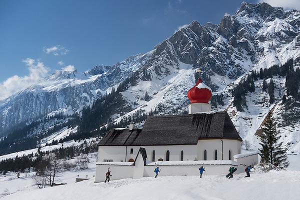 Skiers and snowboarder at base of Stuben Ski Area, St Anton, Austria