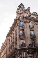 A corner building shows typical Parisian architecture.