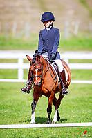 NZL-Morgan Abel-Pattinson rides Glencoe Flowergirl during the Kiwi Arena Rakes Rider Equitation - Fledging. 2018 Equestrian Entries NZ Under 25 Dressage Championships. Saturday 21 April. Copyright Photo: Libby Law Photography