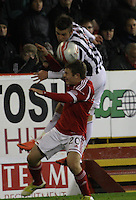 Graham Carey climbs above Ryan Fraser in the Aberdeen v St Mirren Scottish Communities League Cup match played at Pittodrie Stadium, Aberdeen on 30.10.12.