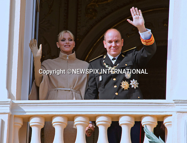 """PRINCESS CHARLENE.looked rather happy with husband Prince Albert paying close attention..Is ther an imminent announcement for the couple who married in July, probably a heir to the Monagasque dynasty. Time will tell..The couple were attending the National Day Fsetivities with other members of the Monaco Royal Family in Monte Carlo, Monaco_19/11/2011.Mandatory Credit Photos: ©Francis Dias/NEWSPIX INTERNATIONAL..**ALL FEES PAYABLE TO: """"NEWSPIX INTERNATIONAL""""**..PHOTO CREDIT MANDATORY!!: NEWSPIX INTERNATIONAL(Failure to credit will incur a surcharge of 100% of reproduction fees)..IMMEDIATE CONFIRMATION OF USAGE REQUIRED:.Newspix International, 31 Chinnery Hill, Bishop's Stortford, ENGLAND CM23 3PS.Tel:+441279 324672  ; Fax: +441279656877.Mobile:  0777568 1153.e-mail: info@newspixinternational.co.uk"""