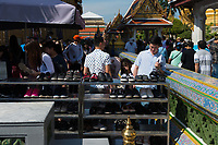 Stand with shoes for tourists near the Temple of Emerald Buddha, Bangkok, Thailand