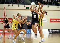 01.09.2010 Silver Ferns Casey Williams and Australian Sharelle McMahon in action during the Silver Ferns v Australia New World netball test match in Wellington. Mandatory Photo Credit ©Michael Bradley.