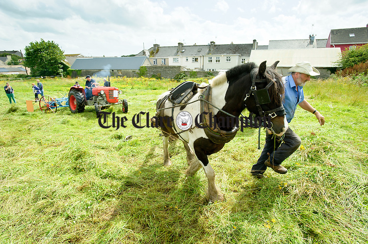 A horse is taken away by Cree's Michael O Dea as Cooraclare's Joe Lillis shakes hay with a vintage machine on a 1966 Zetor 4011 at the field day as part of the Festival of Fun in Kilmihil. Photograph by John Kelly.