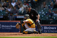 Missouri Tigers catcher Chad McDaniel (20) frames a pitch as home plate umpire Mark Hutchinson looks on during the game against the Oklahoma Sooners in game four of the 2020 Shriners Hospitals for Children College Classic at Minute Maid Park on February 29, 2020 in Houston, Texas. The Tigers defeated the Sooners 8-7. (Brian Westerholt/Four Seam Images)