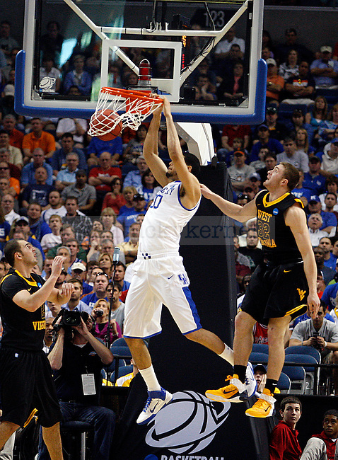 Eloy Vargas makes a dunk in the first half of UK's second round NCAA tournament win, 71-63, against West Virginia at the St. Pete Times Forum in Tampa, Florida on Saturday, March 19, 2011.  Photo by Britney McIntosh | Staff