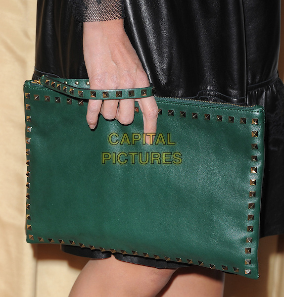 Jessica Alba's bag.Forevermark and In Style 'A Promise of Beauty and Brilliance' held at The Beverly Hills Hotel in Beverly Hills, California, USA..January 10th, 2012.hand studs studded detail fashion green clutch bag                                                                          .CAP/RKE/DVS.©DVS/RockinExposures/Capital Pictures.