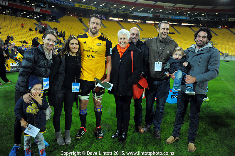 Hurricanes centurion Jeremy Thrush poses with family after the Super Rugby match between the Hurricanes and Waratahs at Westpac Stadium, Wellington, New Zealand on Saturday, 18 April 2015. Photo: Dave Lintott / lintottphoto.co.nz