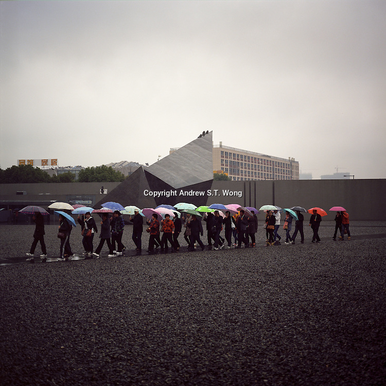 Visitors arrive at Nanjing Massacre Memorial Hall          under heavy rain in Nanjing, Jiangsu province, 2012. (Mamiya 6, 75mm f3.5, Kodak Ektar 100 film)