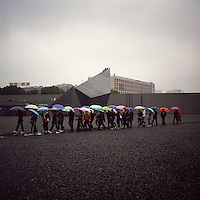Visitors arrive at Nanjing Massacre Memorial Hall          under heavy rain in Nanjing, Jiangsu province, 2012. (Mamiya 6, 75mm f3.5, Kodak Ektar 100 film)
