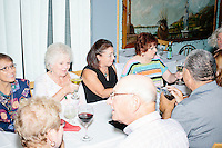 "People gather before Harvard Law professor and Democratic presidential candidate Lawrence Lessig speaks at a meeting of the Salem Democrats at The Colosseum Restaurant in Salem, NH. This campaign event was Lessig's first visit to New Hampshire, though he had not yet raised the $1 million he wanted to raise before officially declaring his candidacy. The following week, Lessig raised the money and declared his candidacy. Lessig is running an unusual campaign, calling himself a ""referendum candidate."" He has said his campaign will focus on a single issue, The Citizen Equality Act, which would reform campaign financing, gerrymandering, and access to voting. Lessig has pledged that, if elected, once the Citizen Equality Act becomes law, he will immediately resign and turn the presidency over to his vice president."
