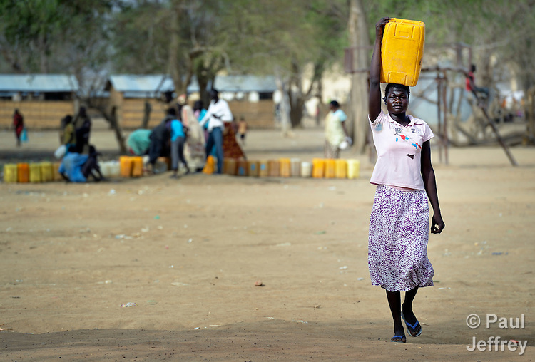 A displaced woman carries water in Agok, a town in the contested Abyei region where tens of thousands of people fled in 2011 after an attack by soldiers and militias from the northern Republic of Sudan on most parts of Abyei. Although the 2005 Comprehensive Peace Agreement called for residents of Abyei--which sits on the border between Sudan and South Sudan--to hold a referendum on whether they wanted to align with the north or the newly independent South Sudan, the government in Khartoum and northern-backed Misseriya nomads, excluded from voting as they only live part of the year in Abyei, blocked the vote and attacked the majority Dinka Ngok population. The African Union has proposed a new peace plan, including a referendum to be held in October 2013, but it has been rejected by the Misseriya and Khartoum.