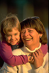 portrait of laughing grandmother with grandchild