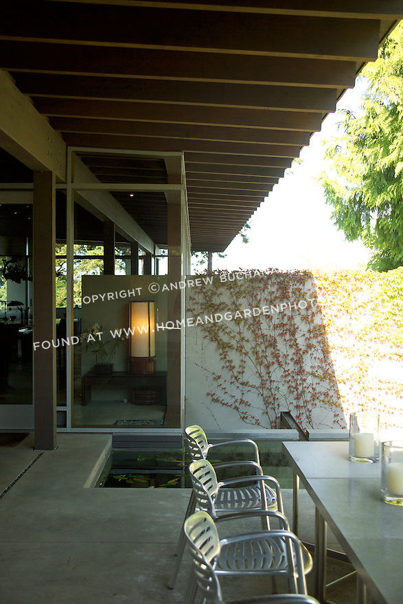 """An AIA Award-winning home in Seattle.  The landscape architect describes it thusly, """"An opening in a bamboo clad concrete wall provides a glimpse into a moss covered auto court. A garden gate opens to reveal a spring box in a walled gravel courtyard. The sound of water directs one to a pond and floating deck adjacent to a sitting room with firebox and dinning table - half covered and half open to the sky. An interior soaking tub abuts an outdoor water box fed by a waterfall.  . . .  A continuous stream engages the house along its northern edge, narrowing and then pooling in the way that people, moving through the house, flow or pause and then gather.. . . The entire journey involves a series of framed views, borrowed scenery, the flow of water and a blending of architecture and landscape so seamless it is often difficult to tell if one is inside or outside."""""""