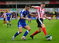 Lincoln City's Harry Anderson shields the ball from Chesterfield's Bradley Barry<br /> <br /> Photographer Andrew Vaughan/CameraSport<br /> <br /> The EFL Sky Bet League Two - Lincoln City v Chesterfield - Saturday 7th October 2017 - Sincil Bank - Lincoln<br /> <br /> World Copyright &copy; 2017 CameraSport. All rights reserved. 43 Linden Ave. Countesthorpe. Leicester. England. LE8 5PG - Tel: +44 (0) 116 277 4147 - admin@camerasport.com - www.camerasport.com