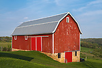 Iowa County, Wisconsin:<br /> Red barn, rolling hills under blue sky