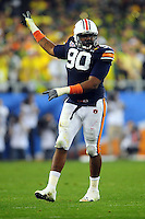 Jan 10, 2011; Glendale, AZ, USA; Auburn Tigers defensive tackle Nick Fairley (90) reacts during the second half of the 2011 BCS National Championship game against the Oregon Ducks at University of Phoenix Stadium.  Mandatory Credit: Mark J. Rebilas-