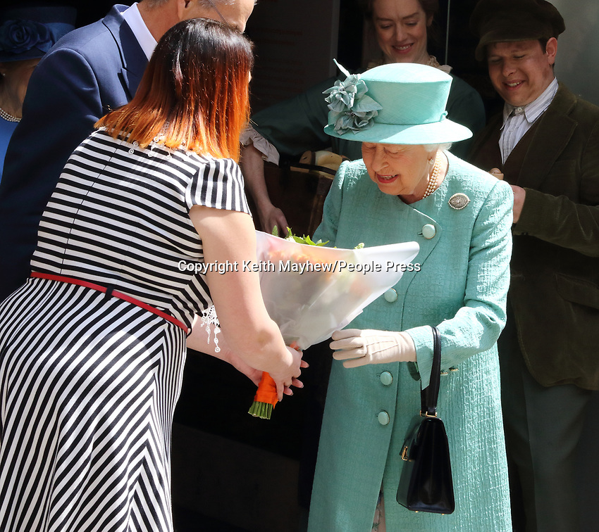 Her Majesty Queen Elizabeth II visits a replica of one of the original Sainsbury's stores in Covent Garden, London, on the occasion of their 150th anniversary.<br />