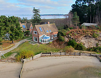 BNPS.co.uk (01202 558833)<br /> Pic: Albury&Hall/BNPS<br /> <br /> Pier Cottage - one of three included in the rent.<br /> <br /> Love Islands ? - Then this idyllic spot in the middle of Poole harbour in Dorset could be the perfect escape.<br /> <br /> 15 acre Round island has been put up for long term rent by its owners for £15,000 a month.<br /> <br /> For that the lucky tenants will get the use of three cottages with space for up to 20 people as well the services of two caretakers who live in another property on the island. <br /> <br /> They provide boat 15 minute boat rides to the mainland at the request of the tenants.<br /> <br /> The nearest shops, restaurants and amenities are three miles away in Poole and the exclusive resort of Sandbanks.