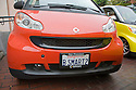 A front view of 'B SMART2 (Be Smart Too) license plate. Smart Car enthusiasts packed approximately 130 of their compact cars into Lombard Street in San Francisco for a photo shoot during a car club rally. Although their gas mileage may not be as high as you might expect from a car this small [city 33 mpg/highway 41 mpg (EPA 2008)*] they definitely put SUVs on notice. *smartusa.com. San Francisco, California, USA